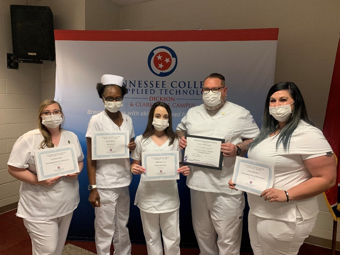 Lyndsay Baker, Joyce White, Addison Lucas, Shane VanDeweghe and Stacey Burdick (left to right) display their certificates of achievement presented during the pinning ceremony.